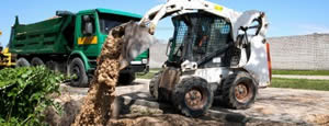 Bobcat and Dumptruck at a Landscape build