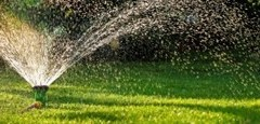 commercial sprinkler system spraying lawn